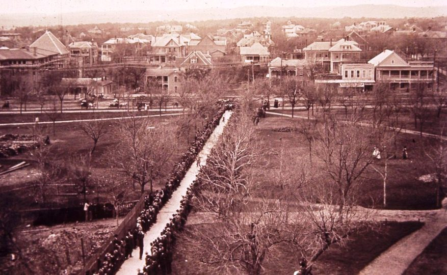Texas legislators walk up future West Mall to Old Main for presentation and lunch