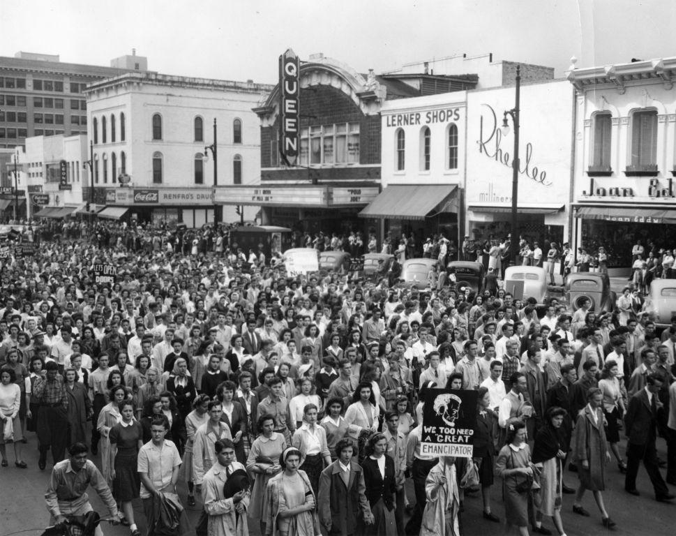 Crowd walking in street protesting President Homer Rainey's firing
