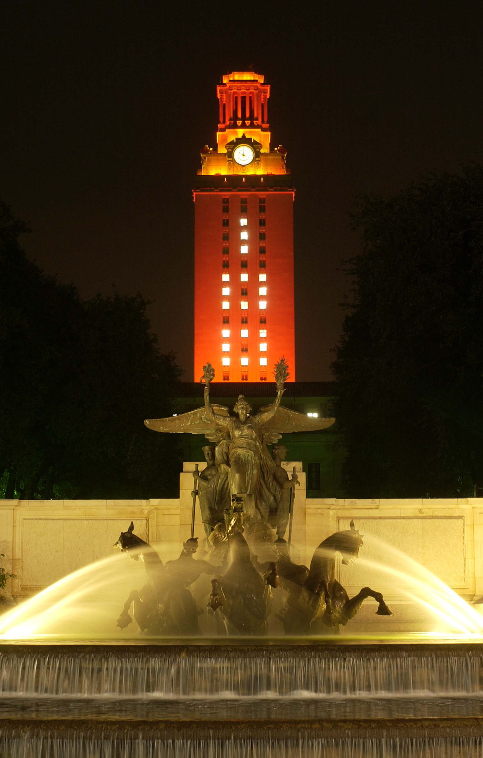 Tower at night with 100 on side